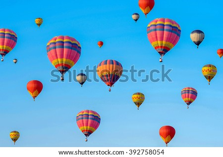 Colorful hot air balloons in blue sky - stock photo