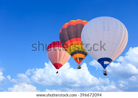 Colorful Hot Air Balloons in Flight over blue sky - stock photo