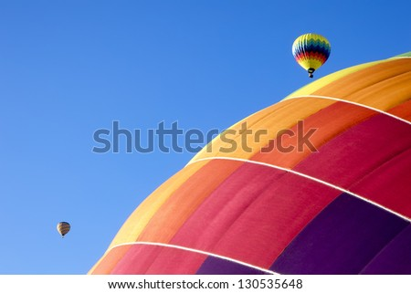 Colorful hot air balloons in flight over Napa Valley, California - stock photo