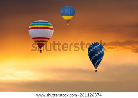 Colorful hot air balloons in golden sky. Balloon Festival. aerostat - stock photo