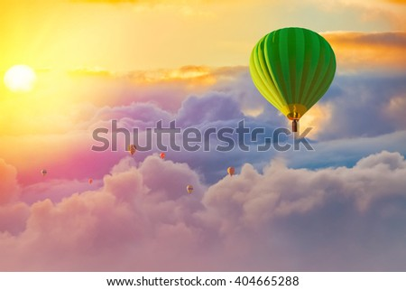colorful hot air balloons with cloudy sunrise background - stock photo