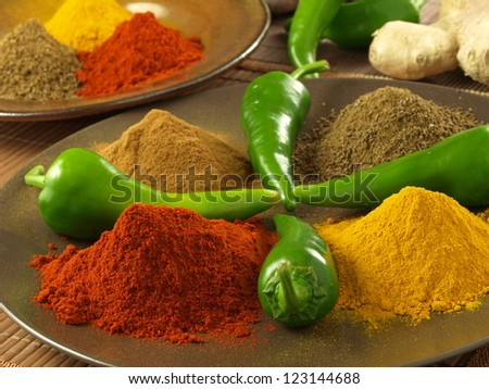 Colorful, hot spices for indian cuisine, closeup - stock photo