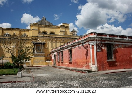 Colorful house and church in the Unesco heritage city Antigua in Guatemala - stock photo