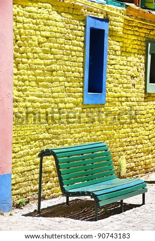 Colorful house of La Boca neighborhood,  or barrio of the Argentine capital, Buenos Aires. It retains a strong European flavour, with many of its early settlers being from the Italian city of Genoa. - stock photo