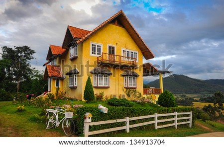 Colorful house on the mountain. - stock photo