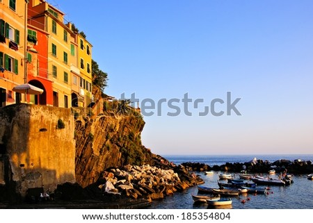 Colorful houses and boats of a coastal village in Italy - stock photo