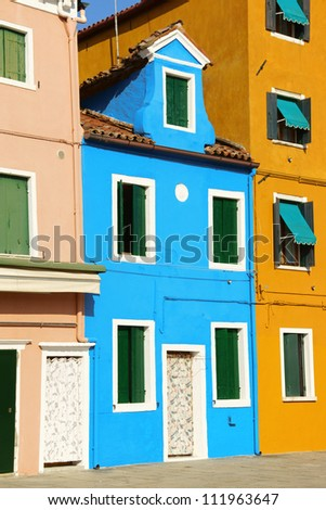Colorful houses in a row on Burano Island in the Venetian lagoon, Venice, Italy