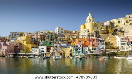 Colorful houses in Corricella village on Procida island at night, Italy