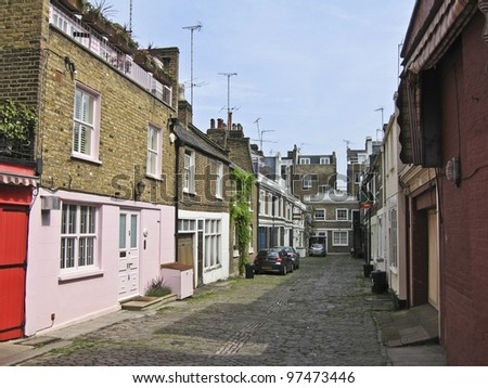 Colorful houses in Notting Hill district, London UK - stock photo