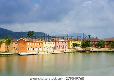 Colorful houses near lake in Thailand. - stock photo