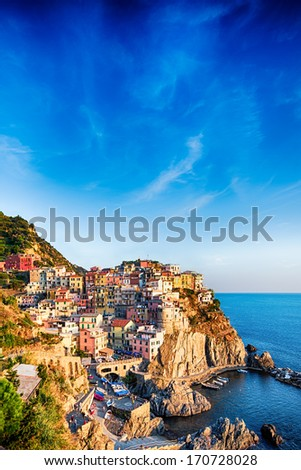Colorful houses of Manarola Cinque Terre under a blue sky, Liguria, Italy - stock photo