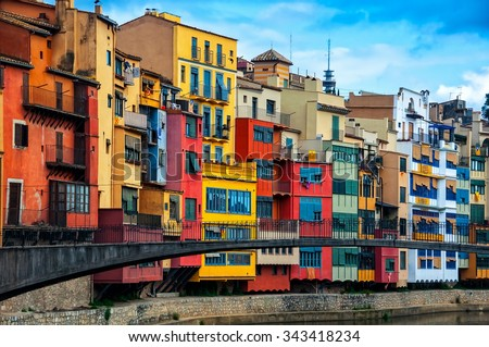 Colorful houses of the city of Girona in Catalonia, Spain. Cloudy blue sky - stock photo
