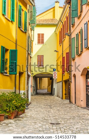 colorful houses on street of Italian town