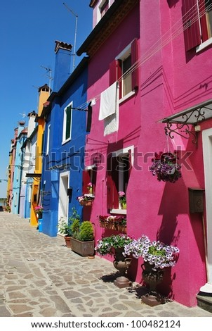 Colorful houses on the canals in Burano Island, Venice, Italy - stock photo