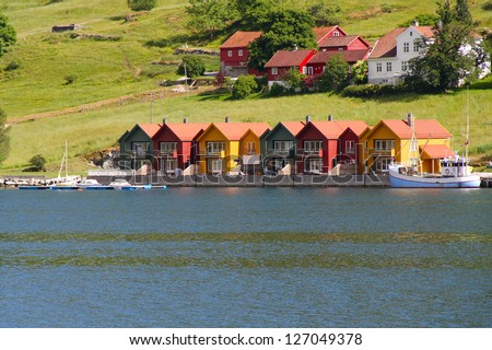 Colorful houses on the shore of Oslo fjord - stock photo