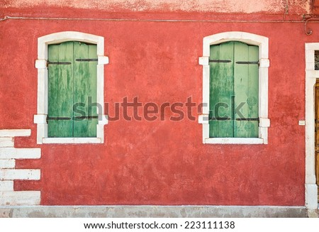 Colorful houses taken on Burano island , Venice, Italy in summer time. Positive color makes beautiful background from them.  - stock photo