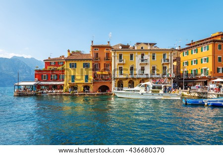 Colorful houses the bay of ancient italian town malcesine at garda lake veneto region italy - stock photo