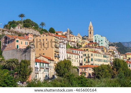 Colorful houses under blue sky in old town of Ventimiglia, Italy.