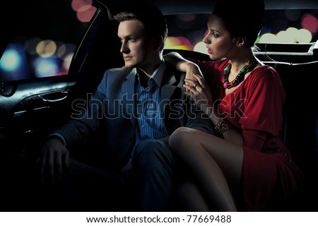 Colorful image of beautiful couple sitting in a limousine - stock photo