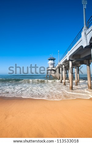 Colorful image of the Huntington Beach pier during an early morning sunrise. - stock photo