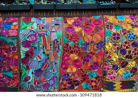 Colorful imported textiles on display in Santa Fe, New Mexico - stock photo