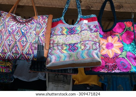 Colorful imported tote bags on display in Santa Fe, New Mexico - stock photo