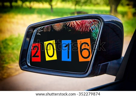 Colorful 2016 in a side mirror of a modern car - stock photo