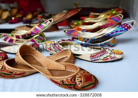Colorful indian ethnic shoes on flea market in India. copy space - stock photo