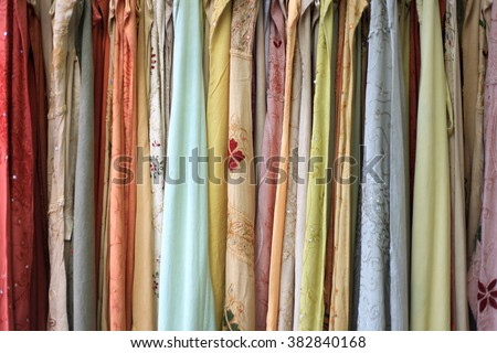 Colorful Indian women costumes up for sale. - stock photo
