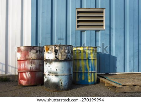 colorful industrial 55 gallon drums - stock photo
