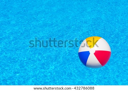 Colorful inflatable ball in swimming pool, summer vacation concept