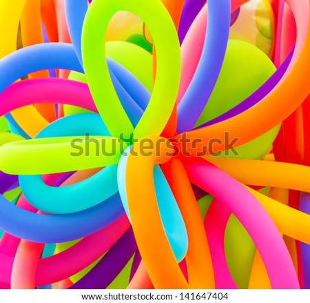 Colorful inflatable balloons background, abstract festive backdrop, birthday celebration, long filled helium balloon, happy holiday concept  - stock photo
