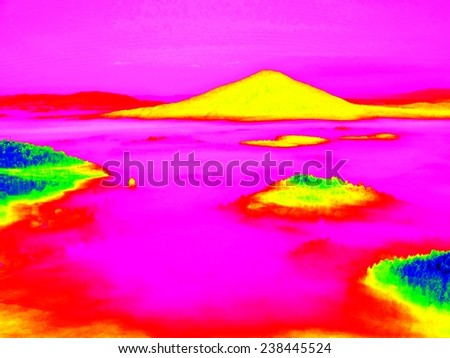 Colorful infrared photo of hilly landscapewith colorful fog, hot sunny sky above. Amazing thermography colors. - stock photo