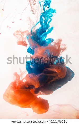 Colorful ink in water on a white background - stock photo