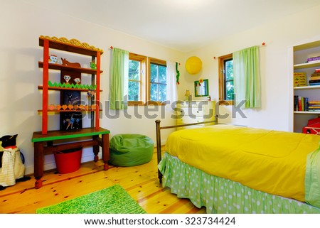 Colorful interior of kids bedroom with yellow and green theme. - stock photo