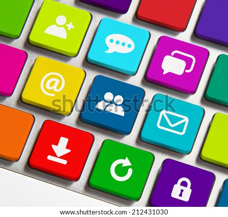 Colorful Internet icons on keyboard button - stock photo