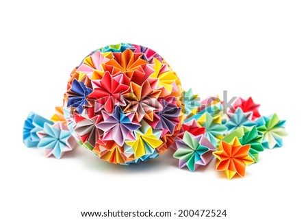 Colorful Japanese Kusudama (medicine ball) and several pyramidal Kusudama pieces on a pure white background - stock photo