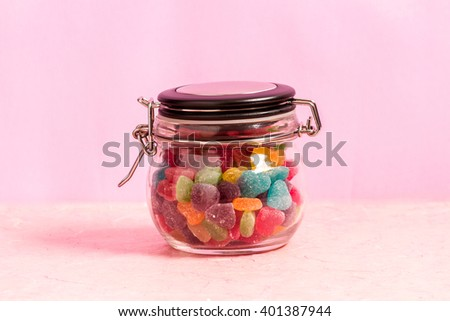 Colorful jellies and candies sweets heart-shaped on background - stock photo