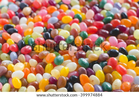 Colorful jelly beans candy background, selective focus