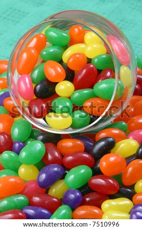 Colorful jelly beans in a glass container. - stock photo