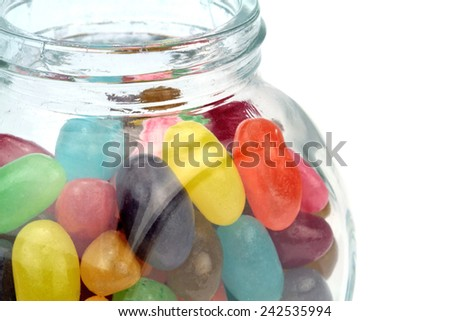 Colorful jelly beans in jar . Macro shot.