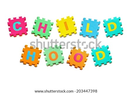 colorful jigsaws arranged as a word childhood - stock photo