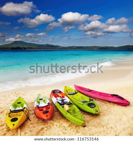 Colorful kayaks on the tropical beach