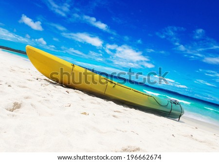 Colorful kayaks on the tropical beach - stock photo
