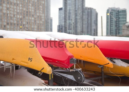 Colorful Kayaks stored for winter