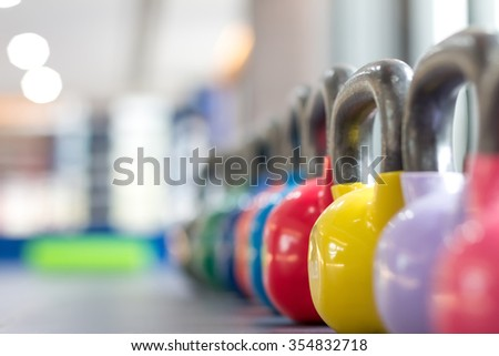 colorful kettle bell on table - stock photo