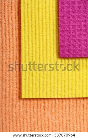 Colorful kitchen sponge rubber foam as background texture. - stock photo