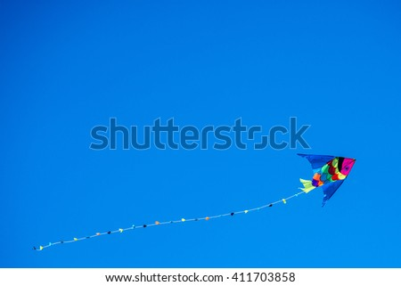 colorful kite flying in the wind bound