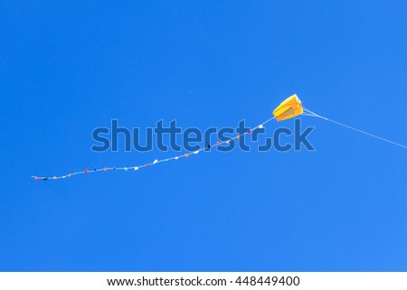 Colorful kite in the cloudy sky