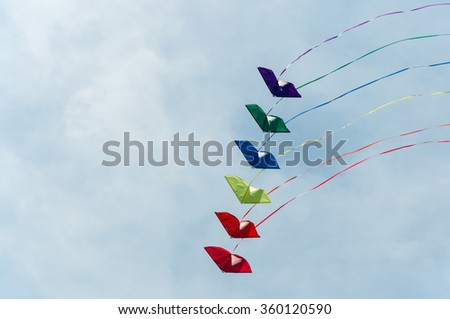 Colorful kite soaring against blue sky. Summer Kite Festival, Canal Days International Kite Show in  City of Port Colborne, Ontario, Canada